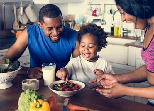 bigstock-Black-family-eating-healthy-fo-237698485.jpg