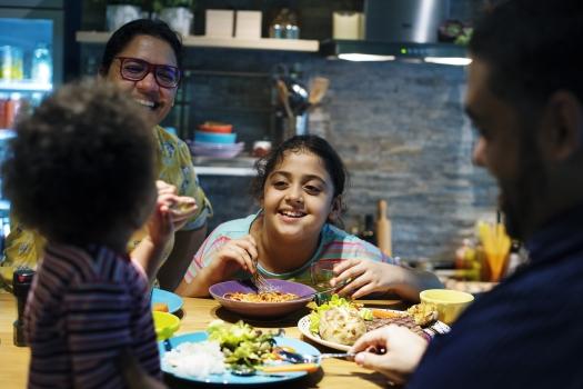 Brazilian family eating dinner together
